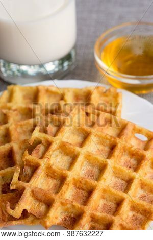 Part Of Orange Waffles With Glass Of Milk