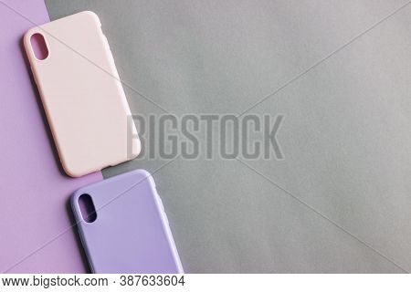Colorful Silicone Cases For Your Smartphone On Light Background. Pink And Purple Cases For The Smart