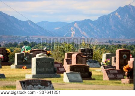 September 28, 2020 In Arvada, Co:  Vintage Headstones Including Fresh Flowers Besides A Few Headston
