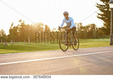 Perfect Cycling Season. Athletic Man In Sportswear, Professional Bicycle Racer In Sportswear Riding