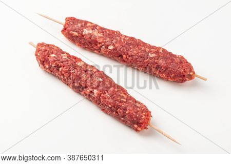Two Wooden Skewers With Minced Beef Meat On White Background
