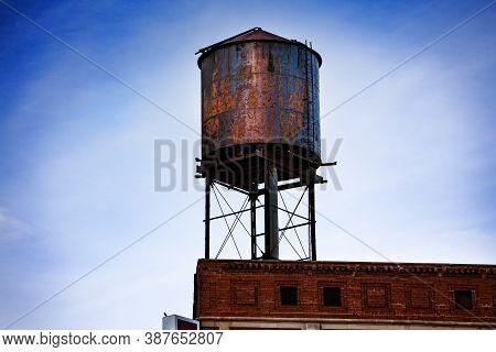 Metal Steel Water Tower On Top Of The Building In Detroit