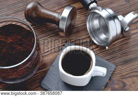 Coffee In A Cup On A Stone Stand, A Glass Jar With Coffee And Coffee Accessories Tempera And A Coffe