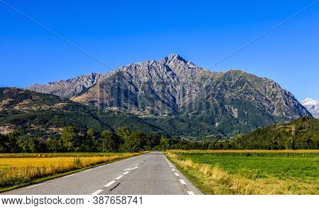Image Of A Road Going Direct To Big Mountains. It Is The Napoleon Road In France Leading To Ecrins M