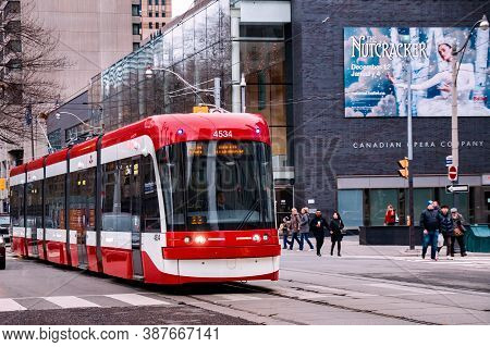 Toronto, Canada - 01 04 2020: A New Bombardier Made Streetcar In Front Of Four Seasons Centre For Th