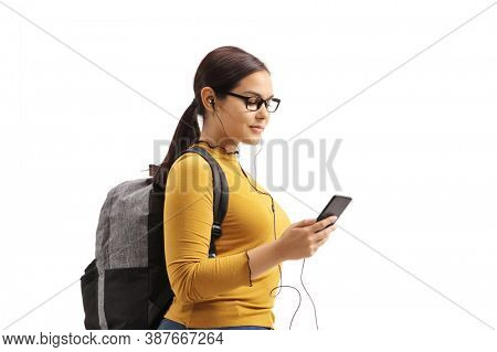 Student with headphones listening music on her mobile phone isolated on white background