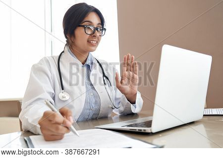 Indian Female Doctor Talk With Patient Make Telemedicine Online Webcam Video Call. Female Physician