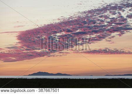 Beach Sunset With Crimson Clouds  At  Richmond British Columbia  Canada
