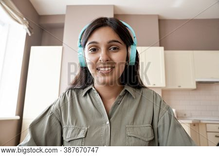 Indian Female College Student Teacher Wearing Headphones Looking At Web Cam Distance Learn Or Teach