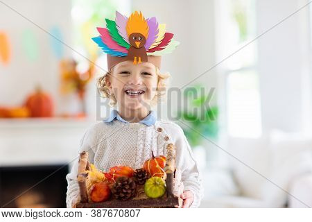 Child On Thanksgiving. Kid With Autumn Turkey Hat.