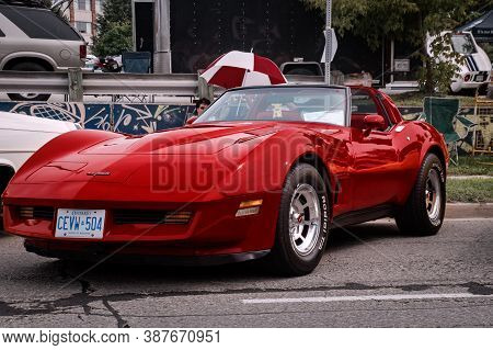 Toronto, Canada - 08 18 2018: Gorgeous Red 1981 C3 Chevrolet Corvette Coupe Oldtimer Car On Display