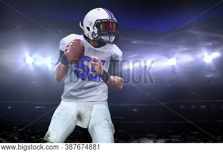 Quarterback  Getting Ready To Throw A Ball During A Game At Night