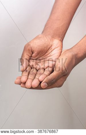 Beggar Hand Signs - Hand Man Holds A Handful, Hands Together. Two Hands With Open Palms Both Tightly