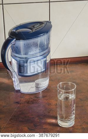 Water Filter Jug With Shungite Cartridge Inside On The Kitchen Counter. Shungite Cartridge For Clean
