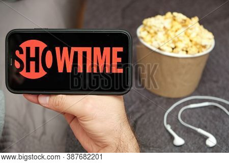 Showtime Logo On The Mobile Phone Screen With Popcorn Box And Apple Earpods On The Background, Septe