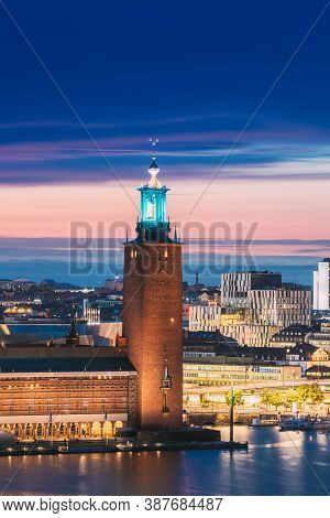 Stockholm, Sweden - June 29, 2019: Close View Of Famous Tower Of Stockholm City Hall. Popular Destin
