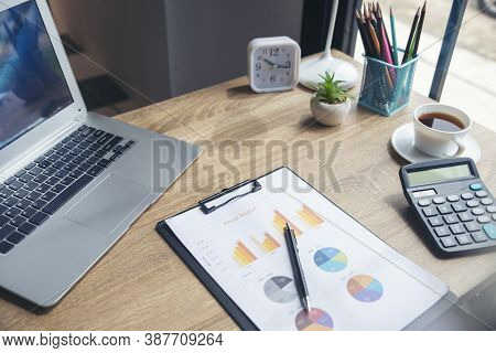 Home Office Desk Concept.laptop, Annual Report And Calculator For Accountant Plan Budget And Tax.com