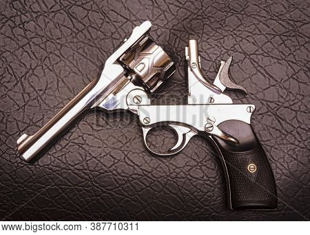 Automatic revolver is a repeating handgun that has a revolving cylinder containing multiple chambers and at least one barrel for firing