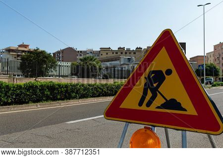 Triangle Sign Work In Progress. Roadworks, Road Signs. Men At Work. Some Signs Signage For Work In P