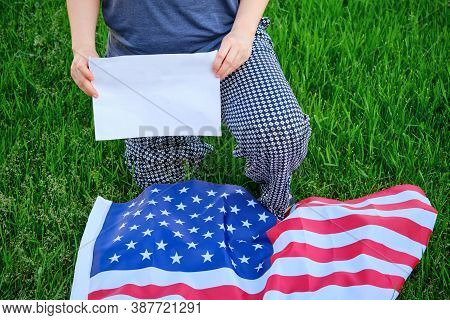 Protest After George Floyd Death, Black Lives Matter, Woman Kneel, Copy Space. Usa Flag, Kneeling