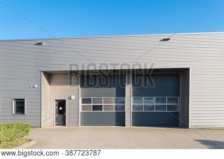 Industrial Unit With Two Grey Roller Doors