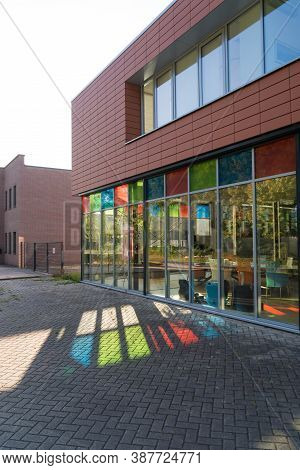 Exerior Of A Modern Office Building With Some Nice Colored Reflections