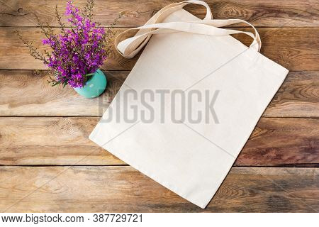 Canvas Tote Bag Mockup With Purple Wildflowers. Rustic Linen Shopper Bag Mock Up For Branding Presen