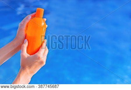 Orange Bottle Of Sun Protection Body Suntan Lotion, Moisturizing Sunblock Cosmetic Sunscreen Product