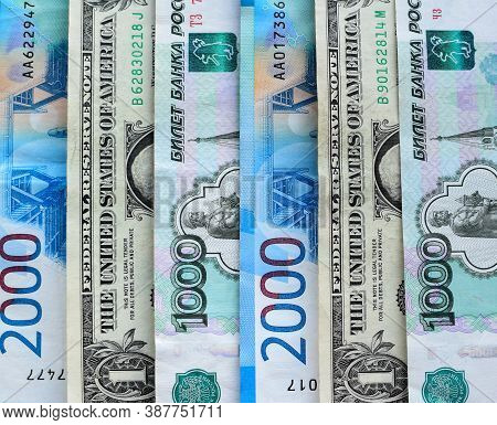 Us Dollars And Russian Rubles, Money Background. Financial Crisis, Ruble Devaluation Concept.