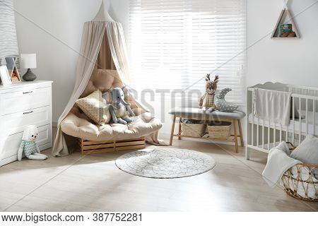 Beautiful Baby Room Interior With Comfortable Armchair And Bench Near Window