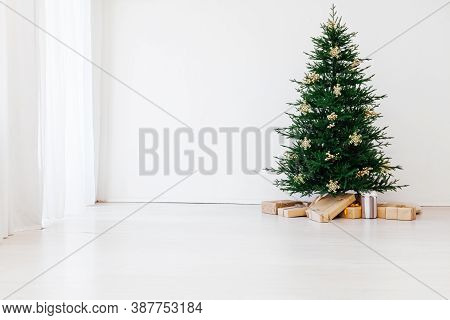Stylish Christmas Scandinavian Minimalistic Interior Christmas Tree With Light And Bauble In Sunny L