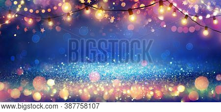 Abstract Christmas Party Background - Golden Glitter With Defocused Effect In Shiny Night And Lights