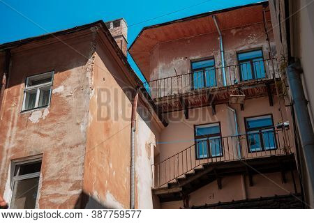 Old City Poor Building Ghetto District Exterior Facade Walls And Windows In Eastern Europe Town Stre