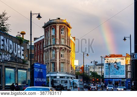 London, United Kingdom - September 14, 2017: Vibrant Rainbow With Flying Plane High In The Sky Above