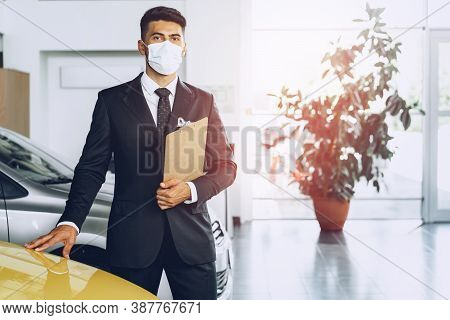 Man Car Dealer Wearing Protective Medical Mask On His Working Place