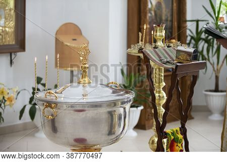 The Interior Of The Church During The Baptism Of A Child. Bath For Baptism.