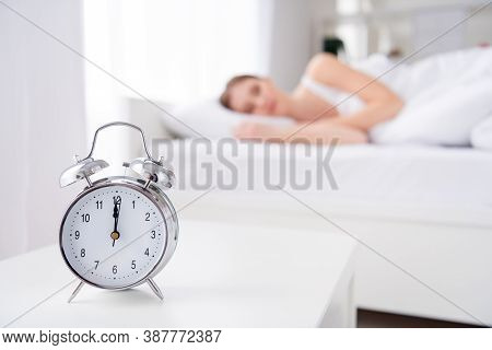 Blurry Focus Photo Of Charming Lady Sleeping Bed White Sheets Blanket Calm Sure Metal Alarm Clock Ri