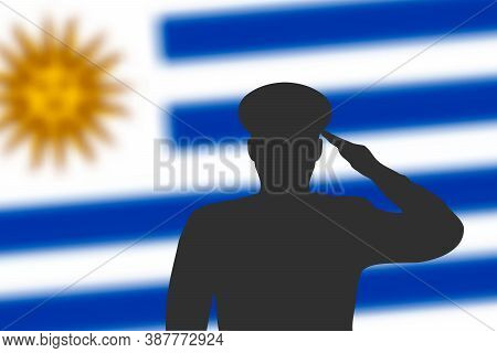 Solder Silhouette On Blur Background With Uruguay Flag.
