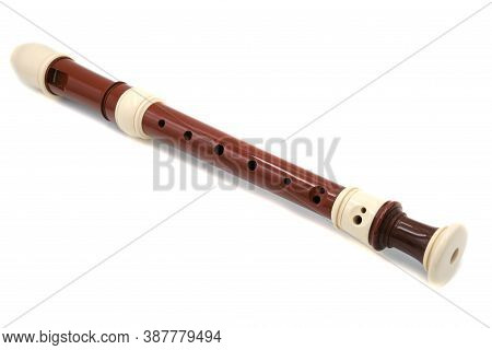 Brown Flute Recorder On A White Isolated Background