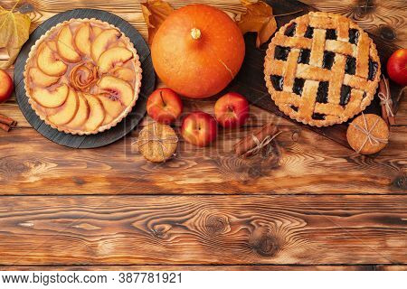Thanksgiving Berry And Apple Various Pies On Wooden Surface, Top View