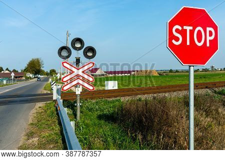 Railroad Crossing And Stop Sign In Farmland Ralway Level Crossing With Warning Sign Stop Nobody Outd