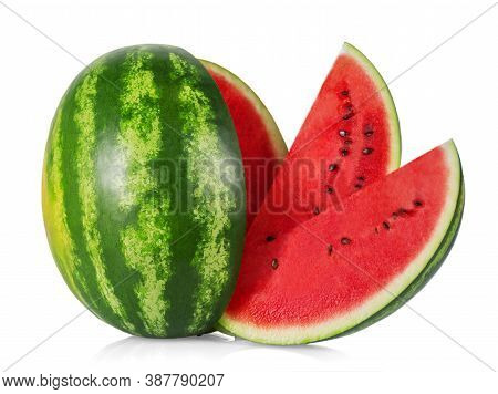 Ripe Juicy Watermelon And Several Slices Isolated On White Background