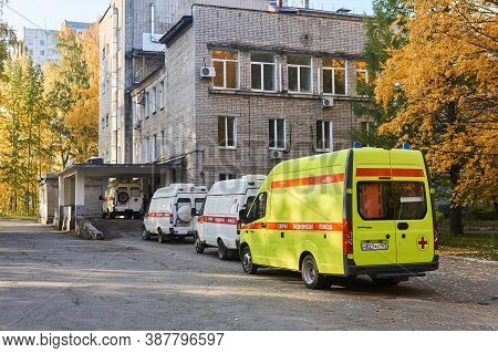 Perm, Russia - October 01, 2020: Ambulances That Brought Patients With Covid-19 Are Waiting In Line