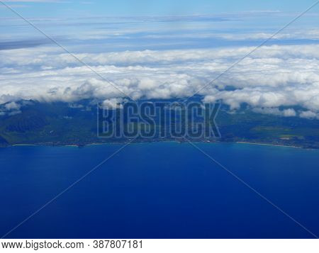 Aerial Of West Coast Of Oahu With Views Of Waiane, Makaha, And Maili With Clouds Hovering Over The I