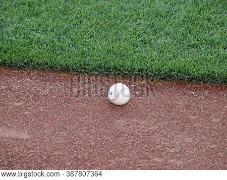 San Francisco - September 28, 2010: Baseball Rest On Edge Of Warning Track Beyond The Outfield Grass