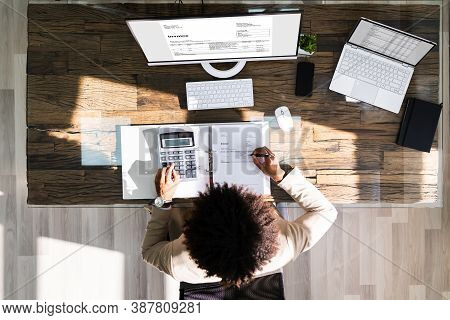 Accountant Using Invoicing Software For Invoice And Budget Work