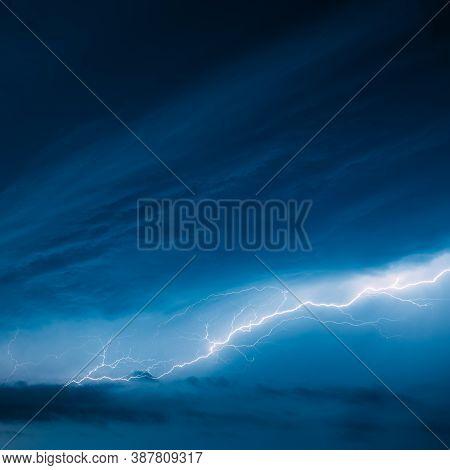 Bright Lightning On Blue Night Sky During Hunderstorm.