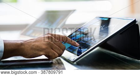African American Financial Business Advisor Using Computer