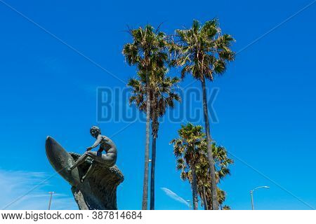 Nude Dude, The Unclothed Surfer Statue In Huntington Beach. Huntington Beach Surfer Statue In Orange