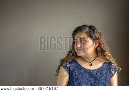 Portrait Of Beautiful Latin Mexican Woman Looking Aside. Chubby Girl